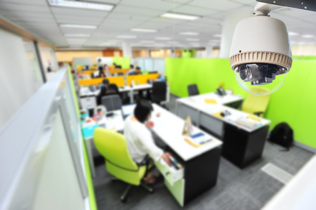 big brother spy: CCTV Camera or surveillance Operating in office building Editorial