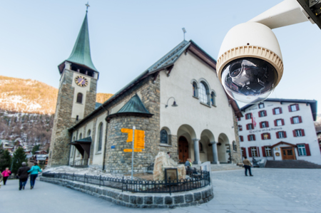 CCTV Camera Operating with church in background photo
