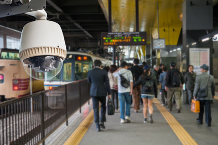 big brother spy: CCTV Camera or surveillance Operating train station