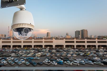 CCTV Camera or surveillance Operating over car park photo