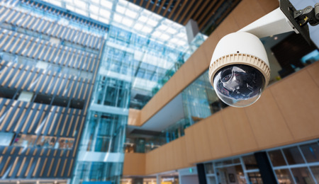 CCTV Camera or surveillance operating on window building photo