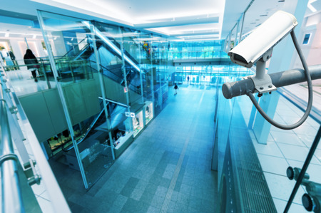 private security: CCTV Camera or surveillance operating in building hightech blue tone