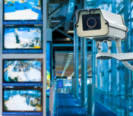 security monitoring: CCTV Camera or surveillance operating with monitor in background Stock Photo