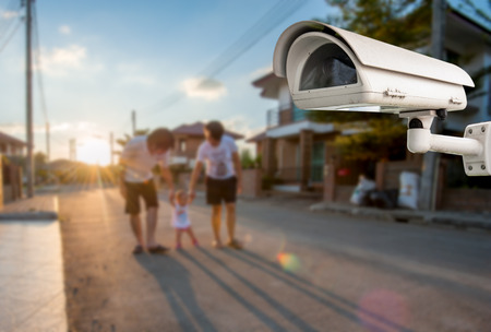 CCTV Camera Operating with family in background of village photo