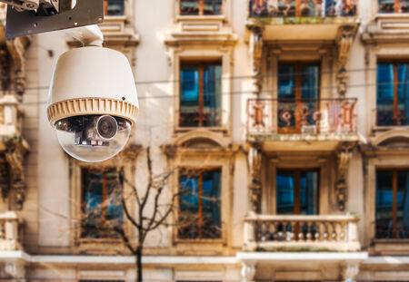 CCTV Camera or surveillance operating on window building photo