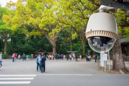 cctv camera: CCTV Camera or surveillance operating in outdoor park with people in japan