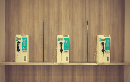 public telephone on wooden wall vintage retro style photo