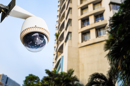 big brother spy: CCTV Camera or surveillance Operating out side apartment or condominium Stock Photo