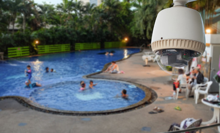 CCTV Camera or surveillance Operating on swimming pool Stock Photo