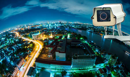 look at camera: CCTV with Blur City in background fish eye perspective
