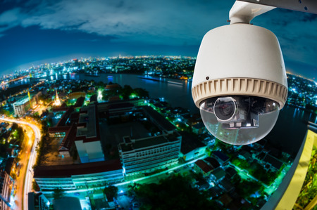 private security: CCTV with Blur City in background fish eye perspective