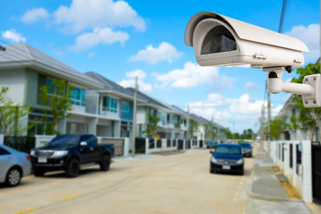 private security: CCTV Camera or surveillance with village in background