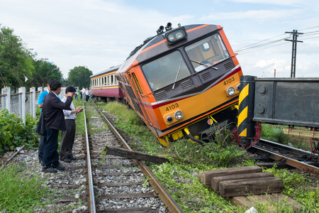 wreck: BANGKOK THAILAND - JULY 31, 2014: train acciden fail of track near Bang Sue station