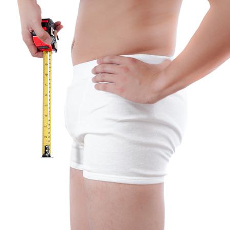 pene: close up di uomo su bianco boxer underware misura del pene isolare su sfondo bianco