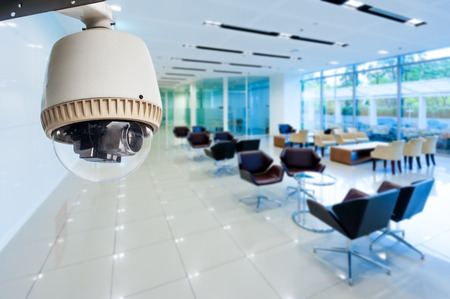 people in office: CCTV or surveillance operating in office building