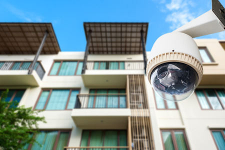 CCTV camera or surveillance operating with apartment in background Stock fotó