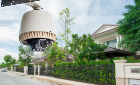 CCTV Camera with house in background photo