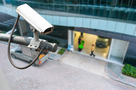 security room: CCTV or surveillance operating on building entrance Stock Photo