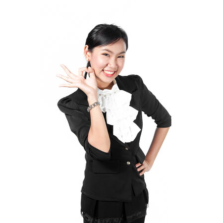 great suit: Young business woman showing okay sign Stock Photo