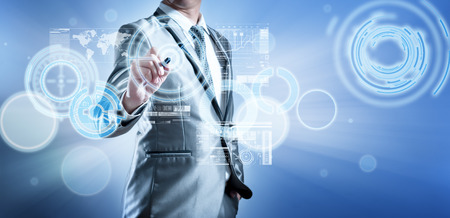 Business man in blue grey suit using digital pen working with digital virtual screen business concept of marketing strategy plan photo