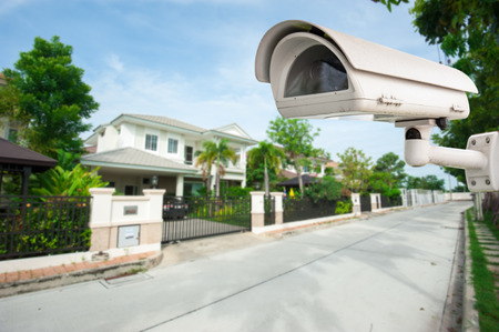 home video camera: CCTV Camera with house in background Stock Photo