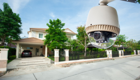 private security: CCTV Camera with house in background Stock Photo