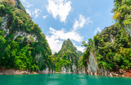 thai dam: Beautiful scene of blue green clear water with rock mountain in Ratchaprapa Dam, Suratthani, Thailand
