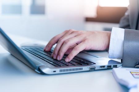 conputer: Close up of business man hands typing on laptop conputer
