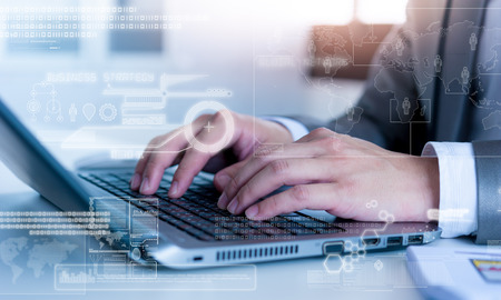 conputer: Close up of business man typing on laptop conputer with technology layer effect Stock Photo