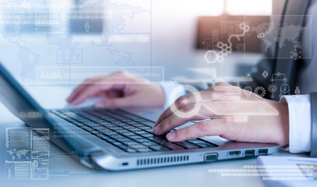 touch technology: Close up of business man typing on laptop conputer with technology layer effect Stock Photo