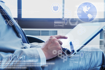 strategy decisions: Business man using tablet with digital layer effect Stock Photo