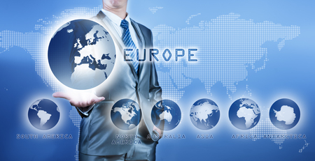 Businessman choosing europe continent on virtual digital screen, business concept of decision making photo