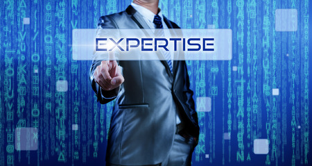expertise: Business man with digital background pressing on button expertise