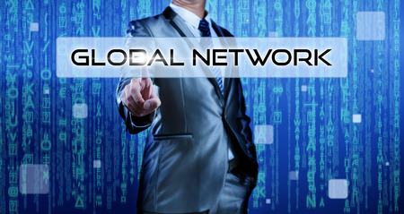 Business man with digital background pressing on button global network photo