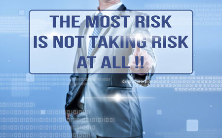 taking a risk: businessman making decision on quote the most risk is not taking risk at all !! Stock Photo