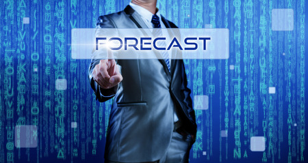 Business man with digital background pressing on button forecast photo