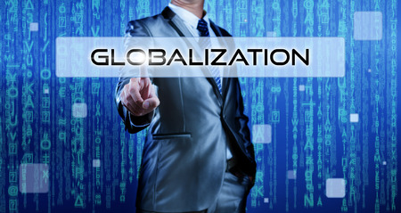 Business man with digital background pressing on button globalization photo