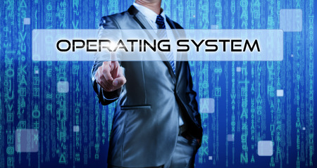 operating system: Business man with digital background pressing on button operating system