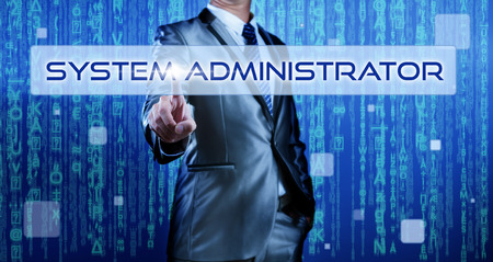 administrators: Business man with digital background pressing on button system administrator