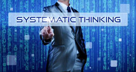 systematic: Business man with digital background pressing on button systematic thinking Stock Photo