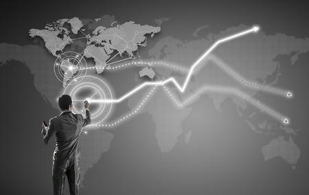 strategic plan: Businessman working on digital virtual screen, globalization marketing conceptual