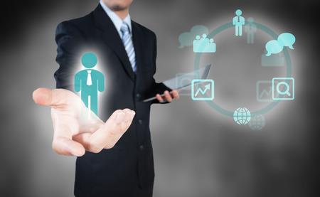 Besluitvorming zakenman die op de menselijke werving resource Stockfoto