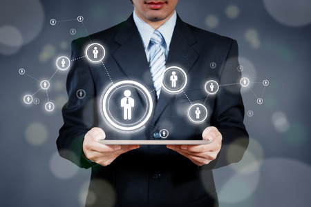 Businessman using tablet with digital visual object, human resource concept photo