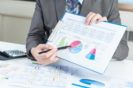 financial analysis: Businessman show report, business performance concept