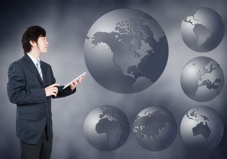 Asian Businessman choosing North america continent, business concept of decision making photo