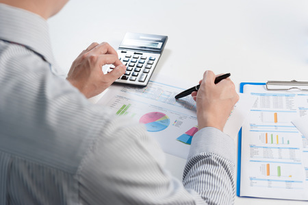 financial performance: Businessman analyzing report, business performance concept