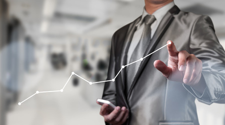 company innovation: businessman working with digital chart, business improvement concept Stock Photo
