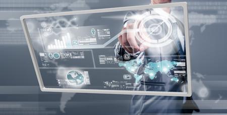 mundo manos: Empresario de trabajo en la pantalla digital, concepto de la tecnolog�a de nueva generaci�n Foto de archivo