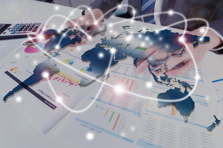 global communication: businessman working with performance report, business globalization concept Stock Photo