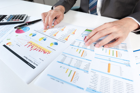 report: Businessman show analyzing report, business performance concept